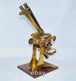 A large Wenham binocular microscope by Ross