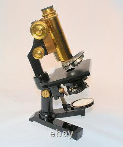An excellent folding, portable microscope in case by Ernst Leitz