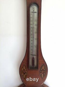 Antique barometer and thermometer wall mounted