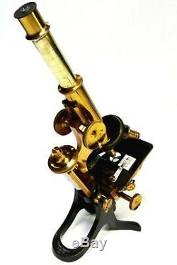 Antique lacquered brass compound microscope by Henry Crouch, London