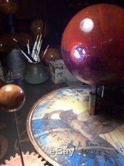 Artist enhanced to look antique tellurium planetarium orrery solar system model