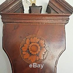 Lione and Somalvico 1812 Georgian mahogany wheel barometer with satinwood