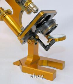 R & J Beck compound microscope in case